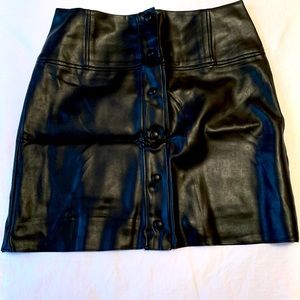 Faux leather Aritzia skirt. Never worn. Runs small